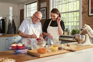 Actor Suranne Jones makes cupcakes with Paul Hoskins for the Alzheimer's Society Cupcake Day on June 13 SUS-190406-154829001