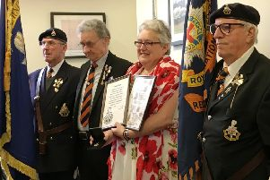 Members of the Royal Sussex Regiment presented Arundel railway station sales clerk Laura Lee with framed mementoes and a Royal Sussex pin