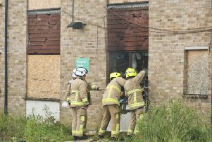 Fire crews at the derelict flats in Burgess Hill on Sunday. Photo by Eddie Howland