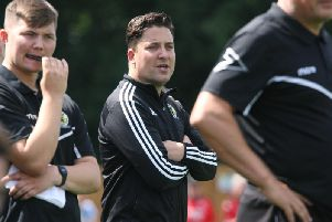 Horsham manager Dominic Di Paola (centre). Picture by Derek Martin Photography