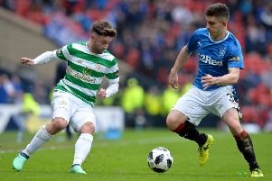 GLASGOW, SCOTLAND - APRIL 15: Declan John of Rangers is challenged by Patrick Roberts of Celtic during the Scottish Cup Semi Final match between Rangers and Celtic at Hampden Park on April 15, 2018 in Glasgow, Scotland.  (Photo by Mark Runnacles/Getty Images) 775143507
