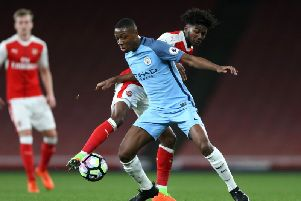 Denzeil Boadu, in action for Manchester City, holds off Ainsley Maitland-Niles during the Premier League 2 against Arsenal and Manchester City. (Photo by Alex Pantling/Getty Images)