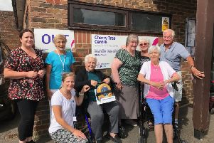 Delighted members and staff outside Age UK's Cherry Tree Centre in Burgess Hill