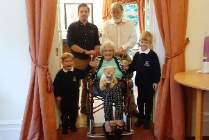 Clare Wills at her 100th birthday party with son Terry, grandson Christopher and great-gradsons Jasper and Stewie SUS-191009-131818001