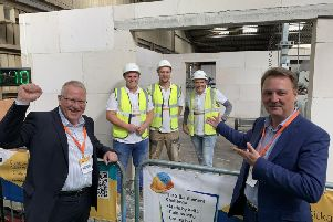 Lissmac construction team with Norman Hinckes, MD of MFS (left) and Koen Buyck, CSO of Xella UK (right) in front of the apartment at the South East Construction Expo held in Ardingly