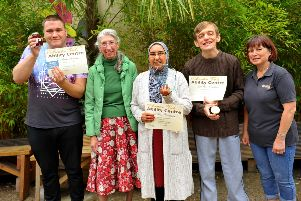 Storrington food producer Aunty Val presents 'Jambuster Supreme 2019' awards to youngsters at the Butterfly Project, Horsham, here with recipients andSupport Worker Dot Reed. Pic Steve Robards SR08101901 SUS-190810-151755001