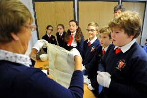St Philip's pupils receiving a demonstration by a museum worker Pic Steve Robards SR22111902
