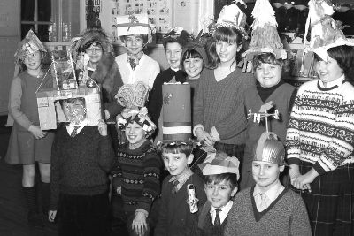 Children at Park School, in Boston, show off their handmade party hats in December