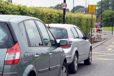 If you do this while driving you could face high fines under