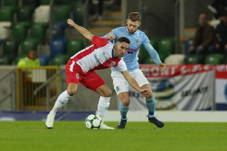 Linfield's Andy Waterworth and Ballymena United's James Knowles