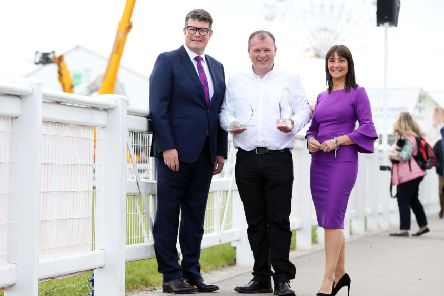 K&G McAtamney, the Ballymena based father and son butchers, have taken home the Overall Supplier of the Year award at the annual Henderson Wholesale Fresh Innovation Awards 2019.'The awards took at this year's Balmoral Show, with K&G McAtamney also taking home the Own Brand Supplier of the Year award.'Pictured with the trophies is Gordon McAtamney along with Neal Kelly (Fresh Foods Director, Henderson Wholesale) and awards host, Jo Scott.     'The awards celebrate Henderson's fresh food suppliers, farmers and growers and reward their product innovation, accessibility of goods and sustainable practices.