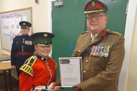 Cadet LCpl Hamilton receives her National Praiseworthy First Aid Award from Colonel Paul Shepherd, Colonel Cadets 38 Brigade.