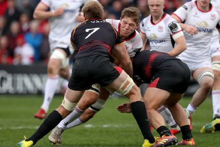 Southern Kings Martinus Burger and Alulutho Tshakweni  tackle Ulster's Matty Rea