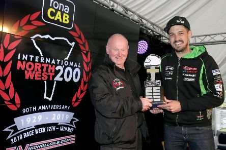 James Hillier receives the Robert Dunlop trophy from North West 200 Event Director, Mervyn Whyte.