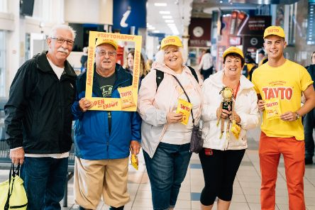 Team Tayto's Adam with #TAYTOHAPPY passengers ready and waiting to board the train to Portrush for The Open