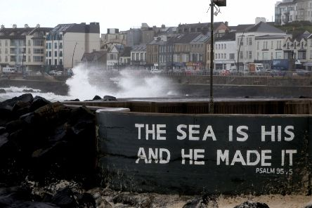 Massive waves break over Portstewart Promenade as a storm rages across the North Coast