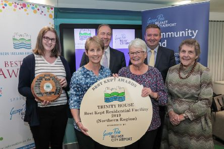 Jayne Bellingham, Donna Kelso and Norma Lockington from Trinity House, Garvagh receiving their award from Seamus McGoran, Chief Executive of the South Eastern Healthcare Trust, Stephen Patton, HR Manager at Belfast City Airport and Doreen Muskett, President of NIAC.
