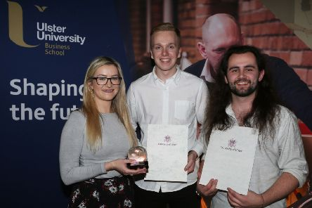 Adam Bingham (left) is presented with his award by Kathryn McIntosh, from sponsors Origin Digital along with joint winner Scott Shaw.