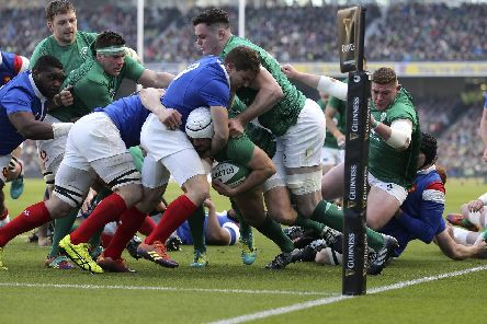 Ireland captain Rory Best crosses for the opening try against France