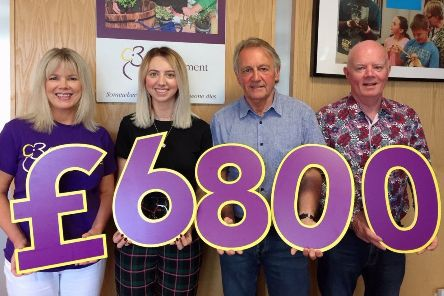 Pictured during the cheque presentation are Elaine Brannigan (Business Development Manager, Cruse NI), Holly Neill, her dad David Neill and Paul Finnegan (Director, Cruse Bereavement Care NI)