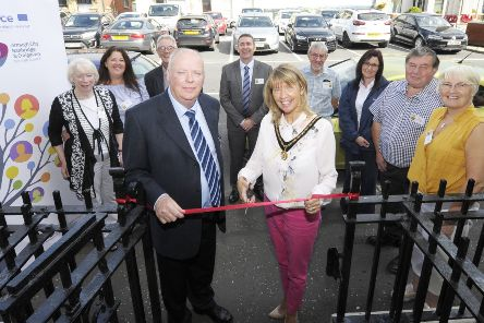 Deputy Lord Mayor for Armagh City, Banbridge and Craigavon Borough, Councillor Margaret Tinsley, is joined by Pat Rafferty Chair of Rathfriland and District Regeneration Company to cut the ribbon and officially open the new Community Hub and Sensory Room in Rathfriland