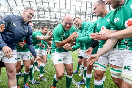 Rory Best is mobbed by his team mates after his last game in the Aviva Stadium