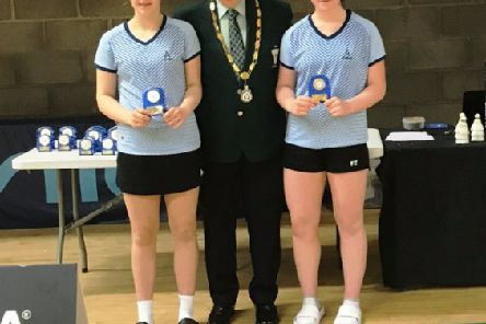 Pictured is Laura, on the right hand side with partner Sophia Noble from Leinster and William Martin, President of Ulster Badminton Association
