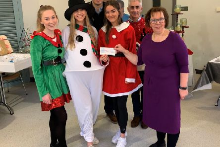 Making the cheque presentation are pupils Larissa Harte, Karis Humphries, Olivia Daly with Mr R S McLoughlin (Principal) and Mr Rodney Coburn (Vice-chair, BAA)