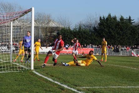Lee Ndlovu turns away after giving Brackley Town the lead against Leyton Orient. Photo: Jake McNulty NNL-190223-160745002