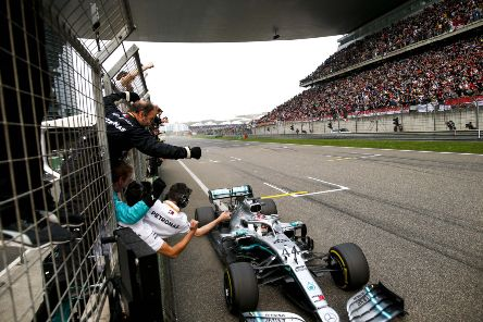 Lewis Hamilton crosses the line to win Sunday's Chinese Grand Prix