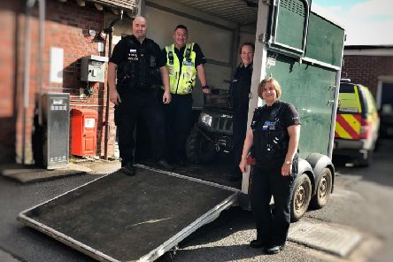 Police officers with the stolen horsebox and quad bike found in Whitfield. Photo: Northamptonshire Police