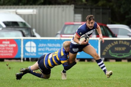 Alex Caviezel Cox tries to get clear during Banbury Bulls' defeat against Old Centralians at the DCS Stadium. Photo: Steve Prouse