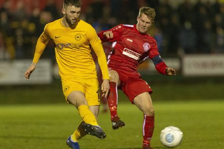 Tudors' skipper Jordan Parkes, in action against Torquay United last Tuesday night, netted twice against Dulwich Hamlet on Saturday. (Picture by Marc Keinch).