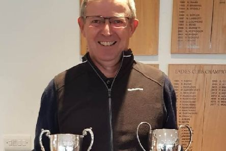 Double-winner Paul Mudd with the Senior Cup and Net Younger Senior Cup at Little Hay Golf Club.