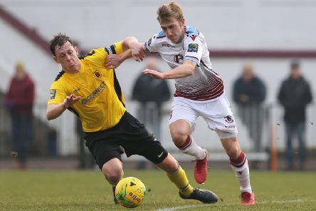 Sam Beale on the ball during Hastings United's 2-1 win at home to Faversham Town. Picture courtesy Scott White