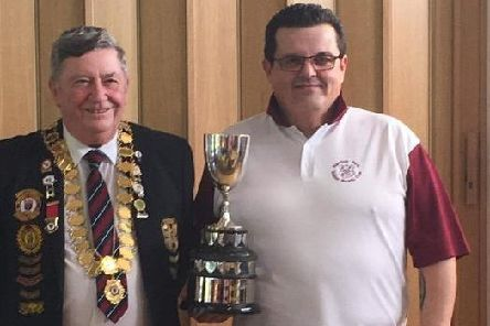 Sussex indoor men's singles champion Rob Morphett with county president Ray Leggatt