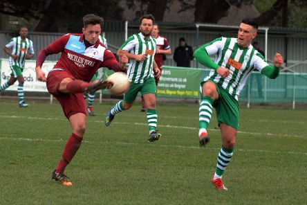 Paul Feakins hooks the ball forward during Little Common's 5-1 defeat away to Chichester City last weekend. Picture by Kate Shemilt