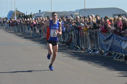 Gary Foster comes home to finish second in the Hastings Half Marathon yesterday morning. Picture by Justin Lycett