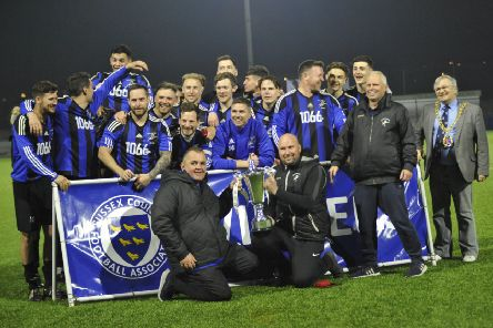Hollington United celebrate winning the Sussex Intermediate Challenge Cup. Picture by Simon Newstead