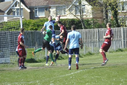 Little Common defend a cross into their penalty area against AFC Uckfield Town