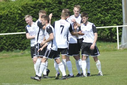 Bexhill United celebrate their second goal in the 2-0 win away to Hailsham Town. Picture by Simon Newstead