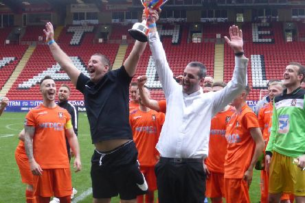 Battle manager Kyle Mann (white shirt) lifts the National Christian Cup