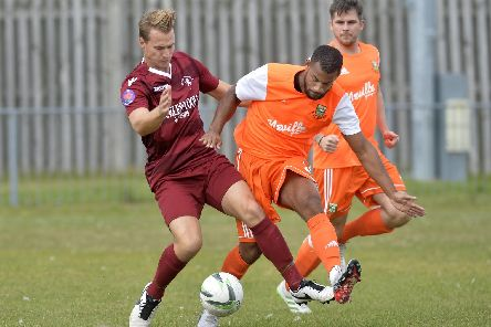 Action from Little Common's FA Cup clash with Hendon. Picture by Jon Rigby