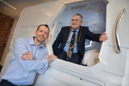 "The mayor of Hastings, councillor Nigel Sinden, ""tops out"" Pod Central in St Leonards. The mayor is pictured with Bryan O'Lynn, managing director of Pod Central. SUS-201102-120036001"