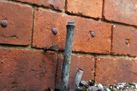 Metal theft leaves pipes exposed              (stock image)