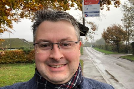 Daniel Norton at one of the rural bus stops in Bedford
