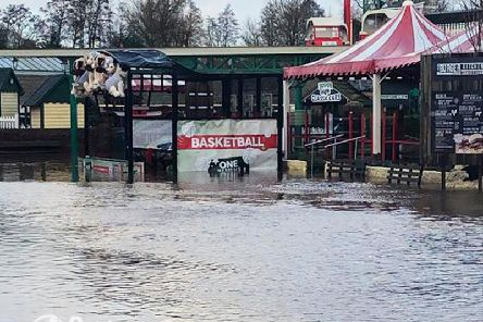 Drayton Manor Park has been left under water after the lake burst its banks