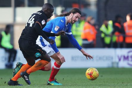 Pompey defender Christian Burgess battles for the ball with Barnet's Simeon Akinola Picture: Jordan Cross