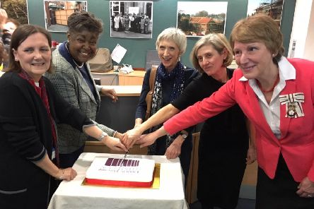 County Archivist Wendy Walker, Cabinet Member for Safer, Stronger Communities Debbie Kennard, West Sussex County Council Leader Louise Goldsmith, Director of Public Engagement at The National Archive Caroline Ottaway-Searle and Lord Lieutenant Mrs Susan Pyper cut the cake.