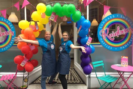 Staff stood proud in the balloon arch